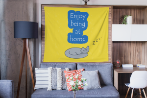 mockup-of-a-wall-tapestry-hanged-over-wooden-furniture-inside-a-living-room-27406