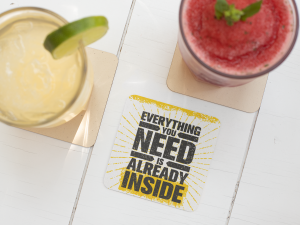 square-coaster-mockup-featuring-two-drinks-on-a-white-wooden-table-27799